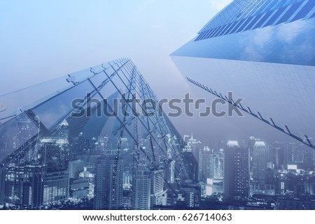 Double exposure, luxury modern highrise buildings and the city can use for business and finance background, blue tone #626714063