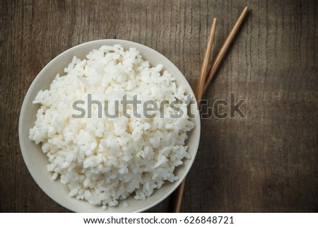 Jasmine rice with chopsticks on wooden table #626848721
