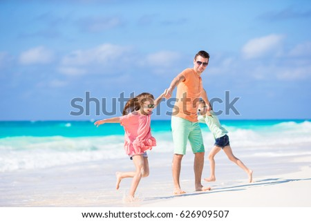 Happy family at tropical beach having fun #626909507