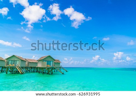 Beautiful water villas in tropical Maldives island #626931995