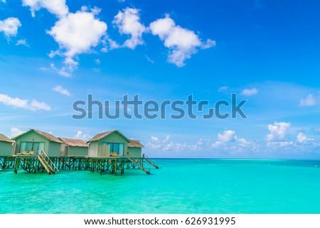 Beautiful water villas in tropical Maldives island #626931995