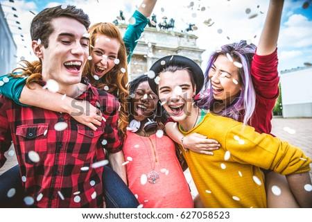 Multi-ethnic group of teens bonding outdoors Royalty-Free Stock Photo #627058523