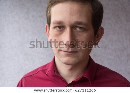 Close up Portrait of a young serious  man looking at the camera. #627111266