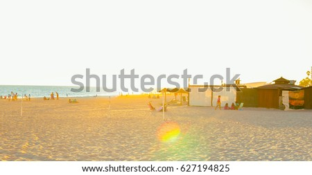 ROTA, SPAIN - SEPTEMBER 09, 2016:  Rota Beach. People enjoying the beach at sunset. Rota, Cadiz #627194825