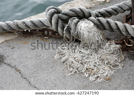 Naval ropes linked to the dock of the harbor #627247190