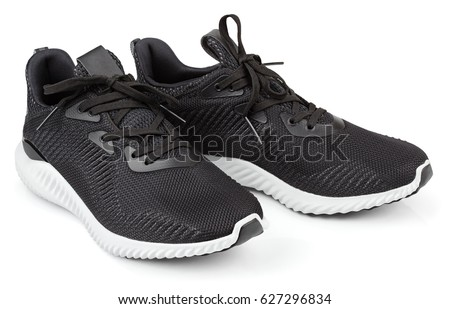 Pair of new unbranded black sport running shoes, sneakers or trainers isolated on white background with clipping path #627296834