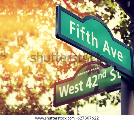 Fifth Avenue and West 42nd Street sign in New York City #627307622
