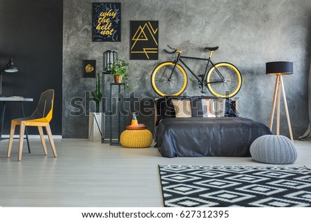 Functional bedroom interior with working area and bicycle #627312395