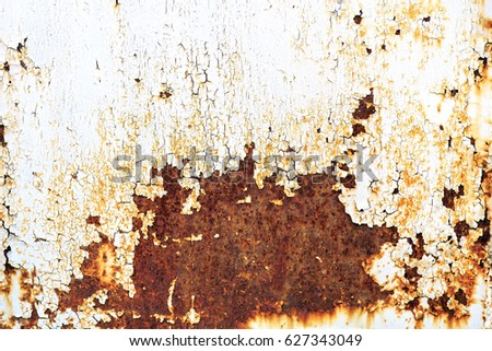 Rusty metal texture background with cracked white paint #627343049