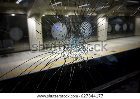 A broken window of a train inside a train station in Athens, Greece, on the 12th of September 2012. #627344177