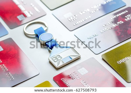 credit cards concept mortgag for new home on white background #627508793