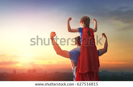 Happy loving family. Dad and his daughter playing outdoors. Daddy and child girl in an Superhero's costumes. Concept of Father's day. Royalty-Free Stock Photo #627516815