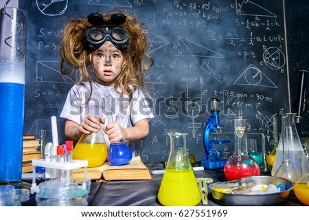 Funny little girl doing experiments in the laboratory. Explosion in the laboratory. Science and education. Royalty-Free Stock Photo #627551969