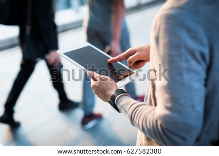 Young man using tablet #627582380