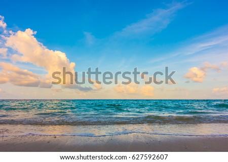 Beautiful sunrise with sky over calm sea  in tropical Maldives island #627592607