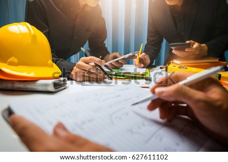 Teamwork of business man contractor working meeting in the office construction site on their architect project. #627611102