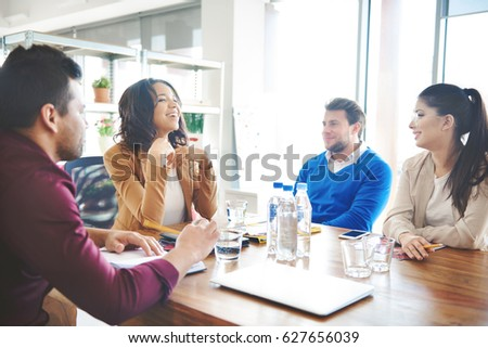 Group of business people discussing at work. #627656039