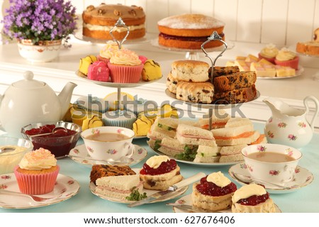 BRITISH AFTERNOON TEA ,SCONES AND CAKES  IN TEA ROOM Royalty-Free Stock Photo #627676406