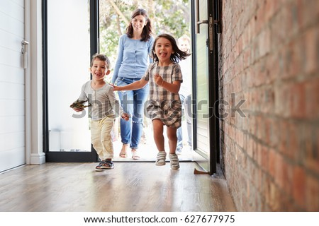 Excited Children Arriving Home With Parents Royalty-Free Stock Photo #627677975