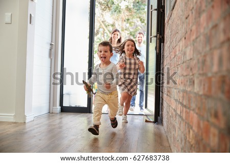 Excited Children Arriving Home With Parents Royalty-Free Stock Photo #627683738