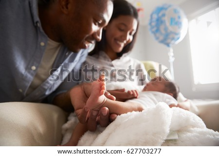 Parents Home From Hospital With Newborn Baby Royalty-Free Stock Photo #627703277