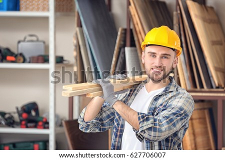 Handsome young carpenter in workshop #627706007