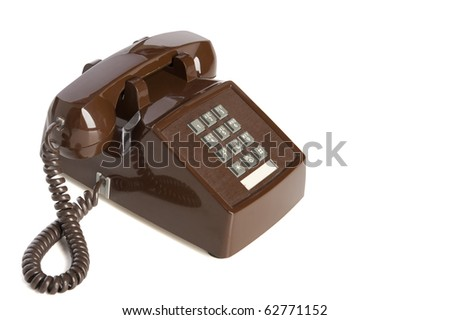 Old brown desk phone viewed at an angle #62771152