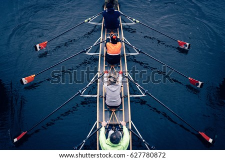 Canoeing team in amsterdam Royalty-Free Stock Photo #627780872