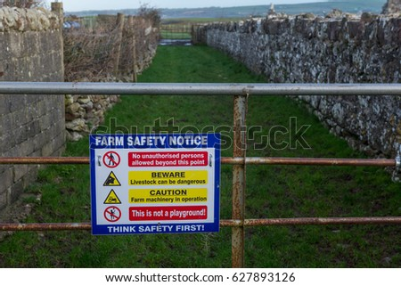 Farm safety notice sign on gate of a rural farm in the republic of Ireland