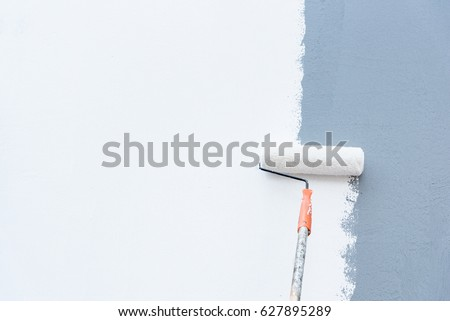 Roller Brush Painting, Worker painting on steel surface wall by the roller brush for protection and corrosion. #627895289