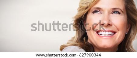 Beautiful elderly woman's portrait. Royalty-Free Stock Photo #627900344