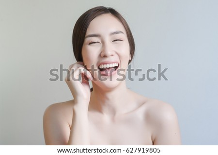 Asian woman with funny face and perfect skin #627919805