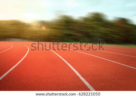 nobody running track for athletic competition, empty motion blur race background for training #628221050