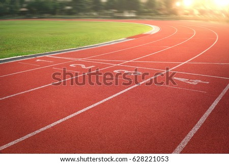 nobody running track for athletic competition, empty motion blur race background for training #628221053