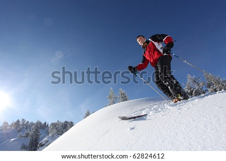 Young man on skis in snow #62824612