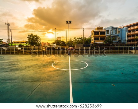 soccer field line, soccer field is under expressway, football field is under expressway, soccer field is urban with Beautiful sunset #628253699