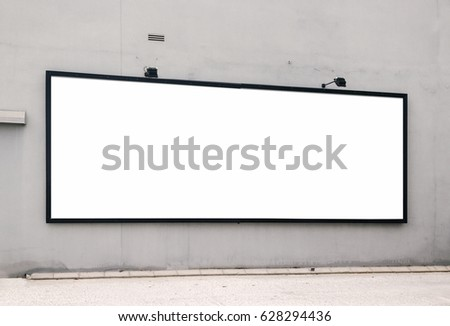 Blank billboard mock up in the city of Javea. Use this photo day mockup for your outdoor design.