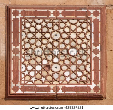 FATEHPUR SIKRI, INDIA - FEBRUARY 15: Beautiful stone carvings on the wall in Fatehpur Sikri complex, Uttar Pradesh, India on February 15, 2016. #628329521