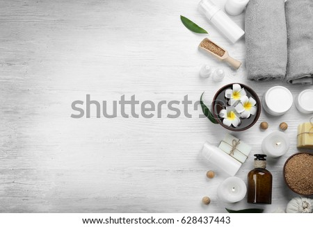 Beautiful spa composition on wooden background #628437443