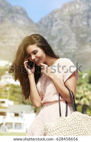 Beautiful brunette on phone, smiling #628458656