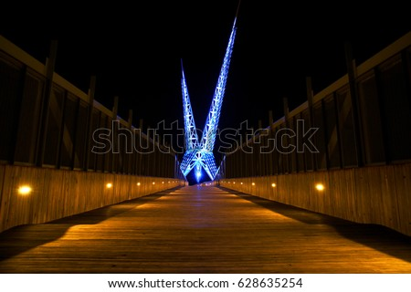 Oklahoma City Wooden Bridge walk way lit up at night over the highway interstate - Long exposure photography
