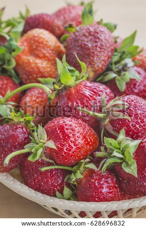Ripe and tasty strawberries in a plate #628696832