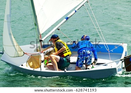 Children having fun sailing Sail boat pictures Lake Macquarie, New South Wales, Australia.