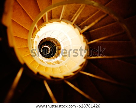 View from above on Old stone staircase in a tower/ Stone Spiral Stairs  #628781426