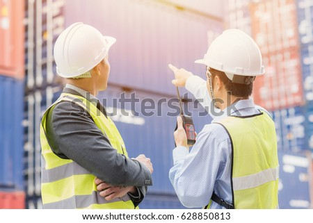 Back view of businessman with staff in logistic, export, import industry checking shipping cargo container freight in. #628850813