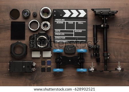 different video making equipment for indie production on brown wooden table view from above. short movie production essentials #628902521