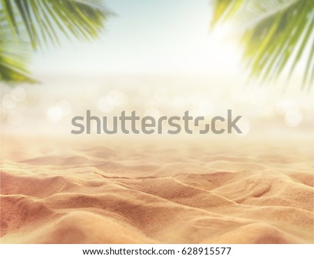 Sand with blurred Palm and tropical beach bokeh background, Summer vacation and travel concept. Copy space Royalty-Free Stock Photo #628915577