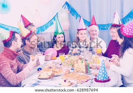 People are happy to celebrate children's birthday during dinner.  #628987694
