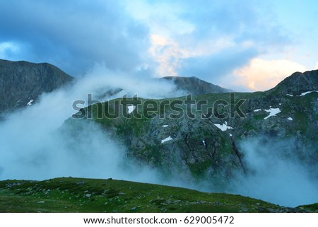 Evening fog up the gorge between mountains. Western Caucasus. #629005472