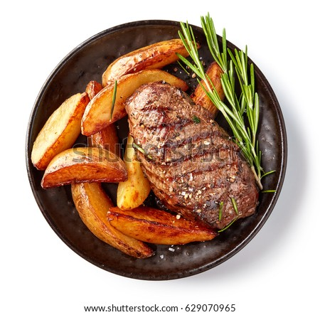 grilled beef steak and potatoes on plate isolated on white background, top view #629070965